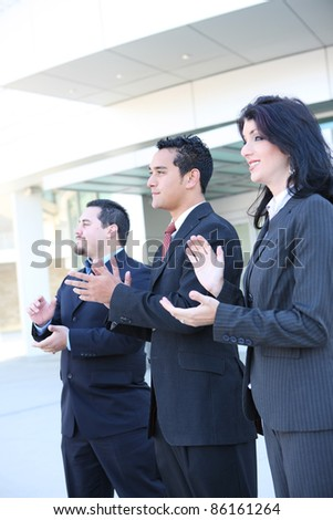 Attractive diverse man and woman business team clapping at office - stock photo