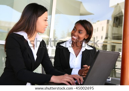 Attractive diverse young women business team at office