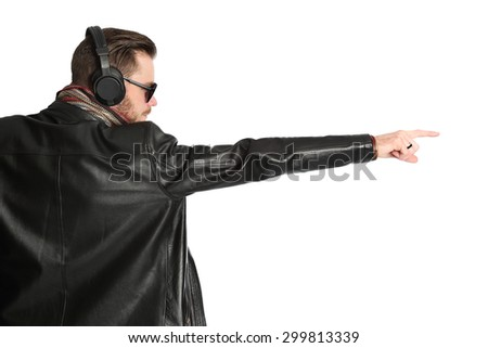 Attractive DJ wearing a black leather jacket and sunglasses with his arms raised, view from behind. White background.