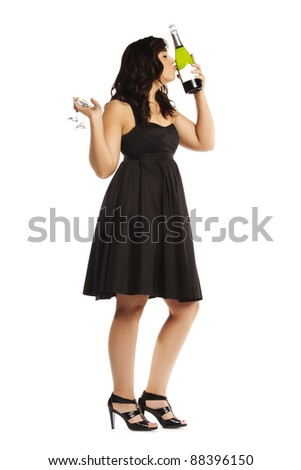 Attractive drunk pretty girl kissing a champagne bottle on white background