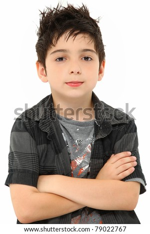 Attractive eight year old portrait of boy with stylish hair over white arms crossed.