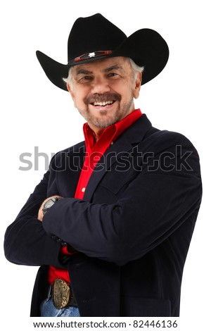 Attractive elderly modern day american cowboy at age 75 over white background. - stock photo