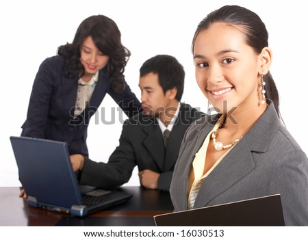 Attractive employee with business people on the background - stock photo