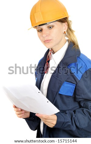 attractive engineer woman reads paper, isolated on white - stock photo