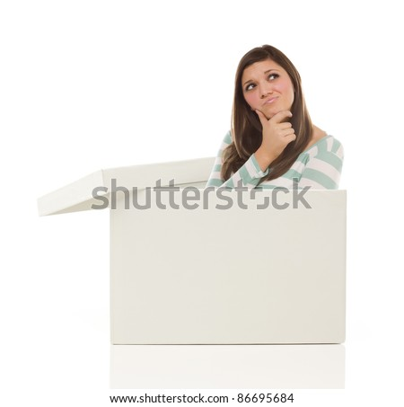 Attractive Ethnic Female Popping Out and Thinking Outside The Box Isolated on a White Background. - stock photo