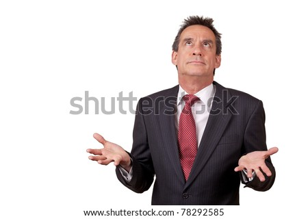 Attractive Exasperated Middle Age Business Man in Suit Raising Eyes and Shrugging - stock photo