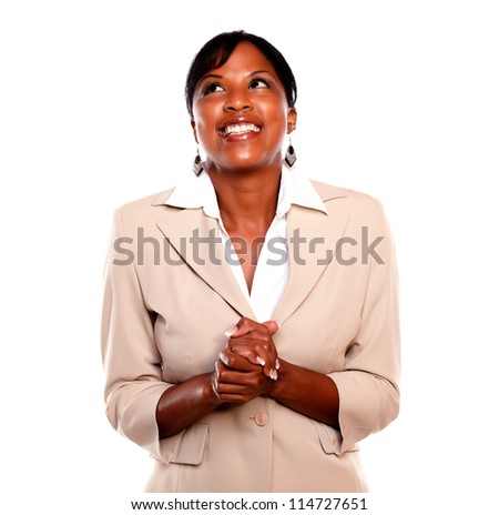 Attractive executive woman smiling and looking up against white background - stock photo