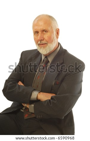 Attractive, experienced businessman in a suit smiling at the camera; isolated on white - stock photo