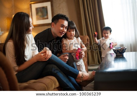 Attractive Family in Lounge - stock photo