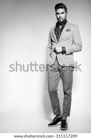 attractive fashion male model dressed elegant - casual posing against  - stock photo