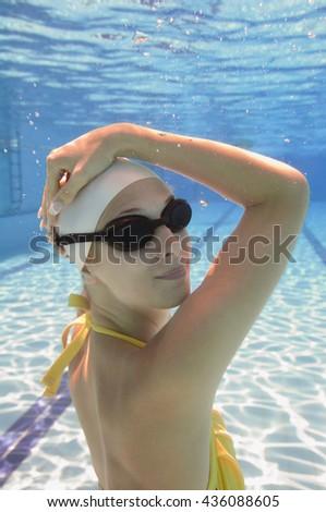 Attractive fashion model posing underwater - stock photo