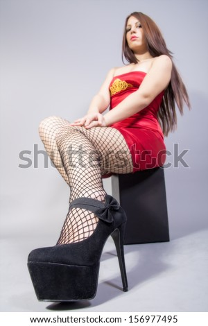 attractive fashion model with long sexy legs - stock photo