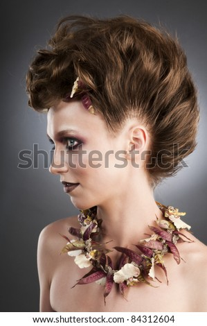 Attractive fashion portrait with floristic necklace.