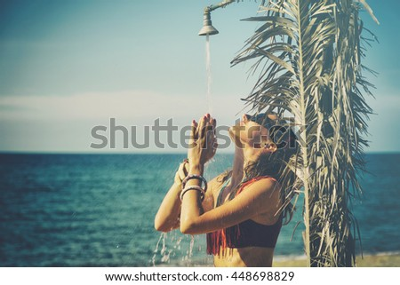 Attractive fashionable woman having fun on the beach.  - stock photo