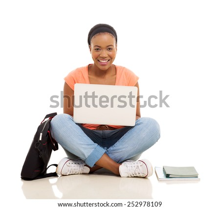 attractive female african college student using laptop isolated on white background - stock photo