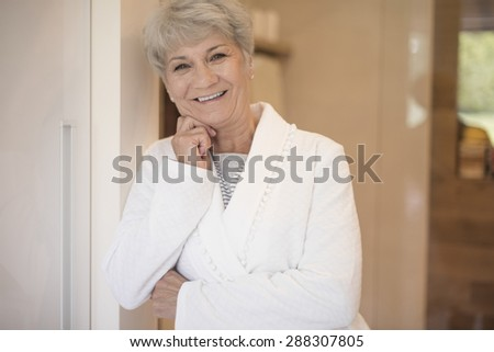 Attractive female at the bathroom door