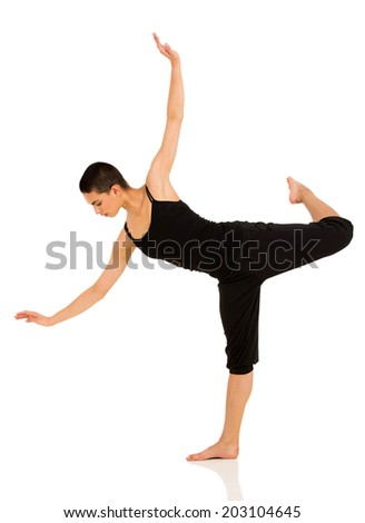 attractive female ballet dancer posing on white background