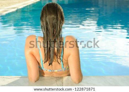 Attractive female beauty enjoying at swimming pool - stock photo
