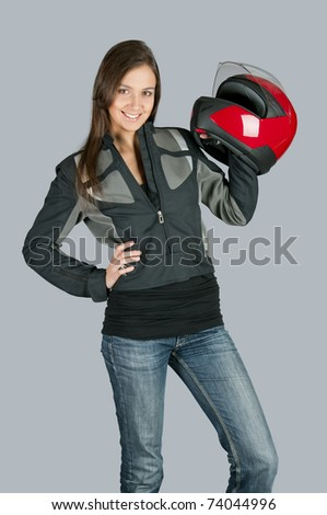 Attractive female biker with with red motorbike helmet.