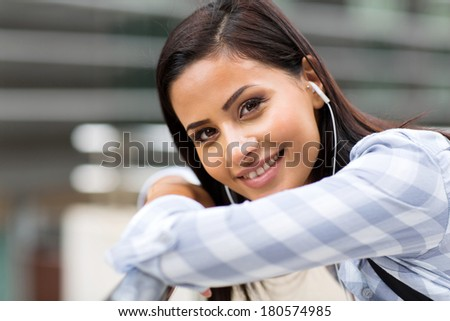 attractive female college student looking at camera - stock photo