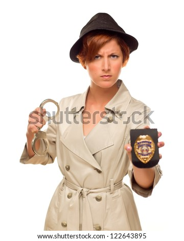 Attractive Female Detective With Handcuffs and Badge In Trench Coat Isolated on a White Background.