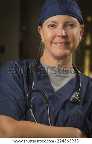 Attractive Female Doctor or Nurse Portrait Wearing Stethoscope. - stock photo