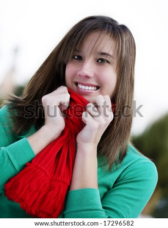 Attractive female dressed in Christmas colors