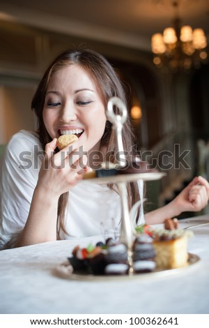 Attractive Female Eating Desserts - stock photo