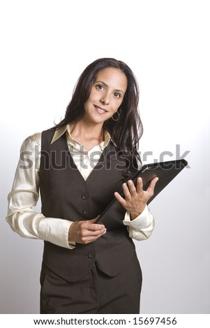 Attractive female executive in business appropriate pose