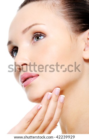 Attractive female face in skincare treatment concept over white background