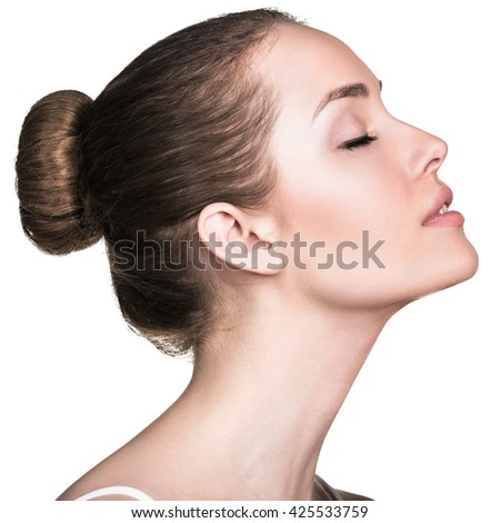 Attractive female face with perfect skin - stock photo