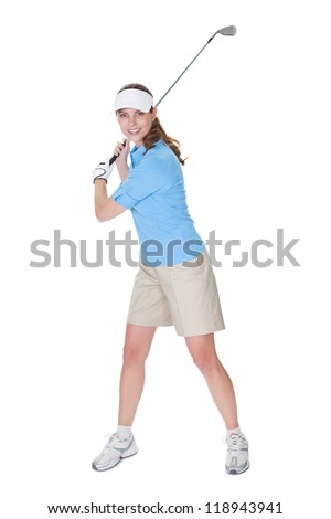 Attractive female golfer in golf clothing with a golf club isolated on white - stock photo