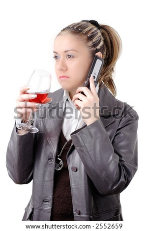 Attractive female having a drink and chatting on the phone