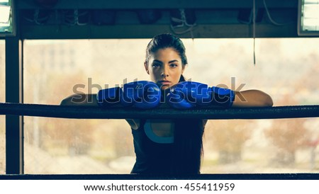 Attractive Female In Boxing Ring Leaning On Rope