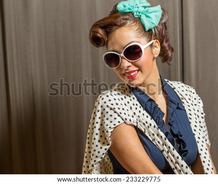 Attractive female in vintage or retro modest yet fun fashion style - stock photo