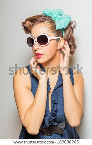 Attractive female in vintage/retro in modest yet fun fashion style