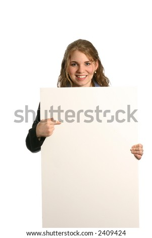 attractive female model giving presentation with blank board - stock photo