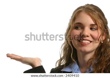 Attractive female model looking to left over outstretched hand - stock photo