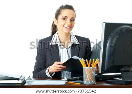 attractive female office worker checks something in her documents, folder, isolated on white background - stock photo