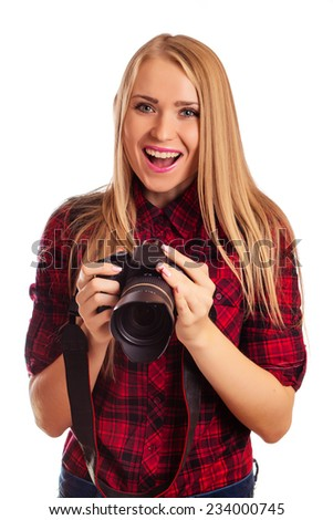 Attractive female photographer holding a professional camera - isolated over white - stock photo
