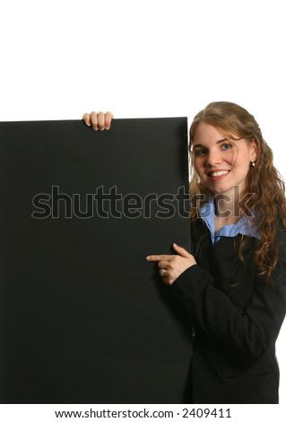 attractive female pointing at graph, chart, or board - stock photo