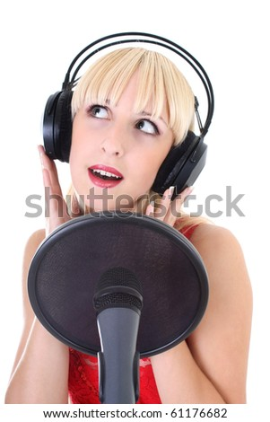 attractive female singer with mic and headphones over white background