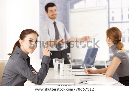 Attractive female sitting at meeting room, listening to presentation.? - stock photo