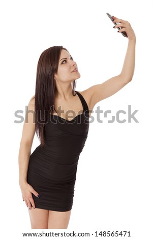 Attractive female smiles for a selfie, isolated on a white background.  - stock photo