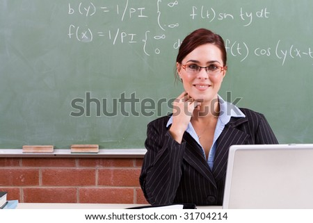 attractive female teacher in classroom