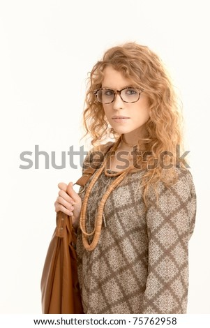 Attractive female wearing glasses going to work holding handbag. - stock photo