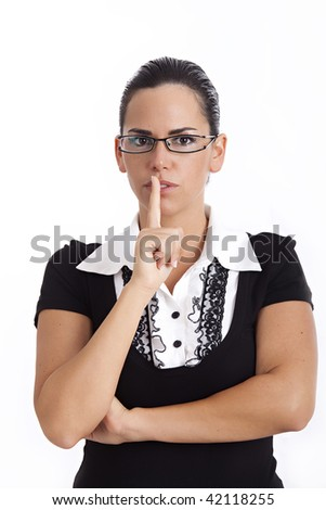 Attractive female with her finger to her mouth gesturing for quiet, isolated on white background. Shh! - stock photo
