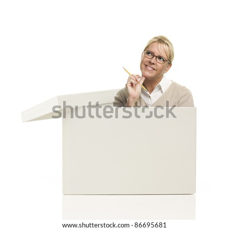 Attractive Female with Pencil Popping Out and Thinking Outside The Box Isolated on a White Background. - stock photo