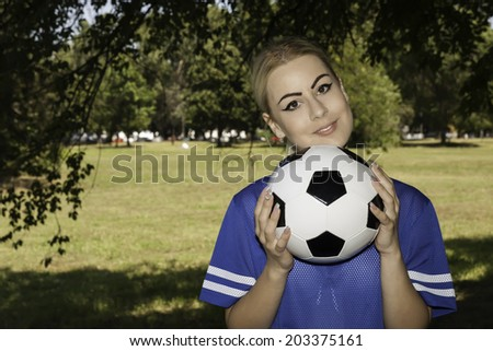 attractive female with soccer ball - stock photo