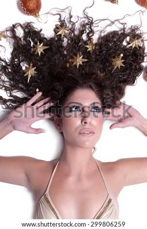 Attractive female woman's face with gold stars on her hair - stock photo